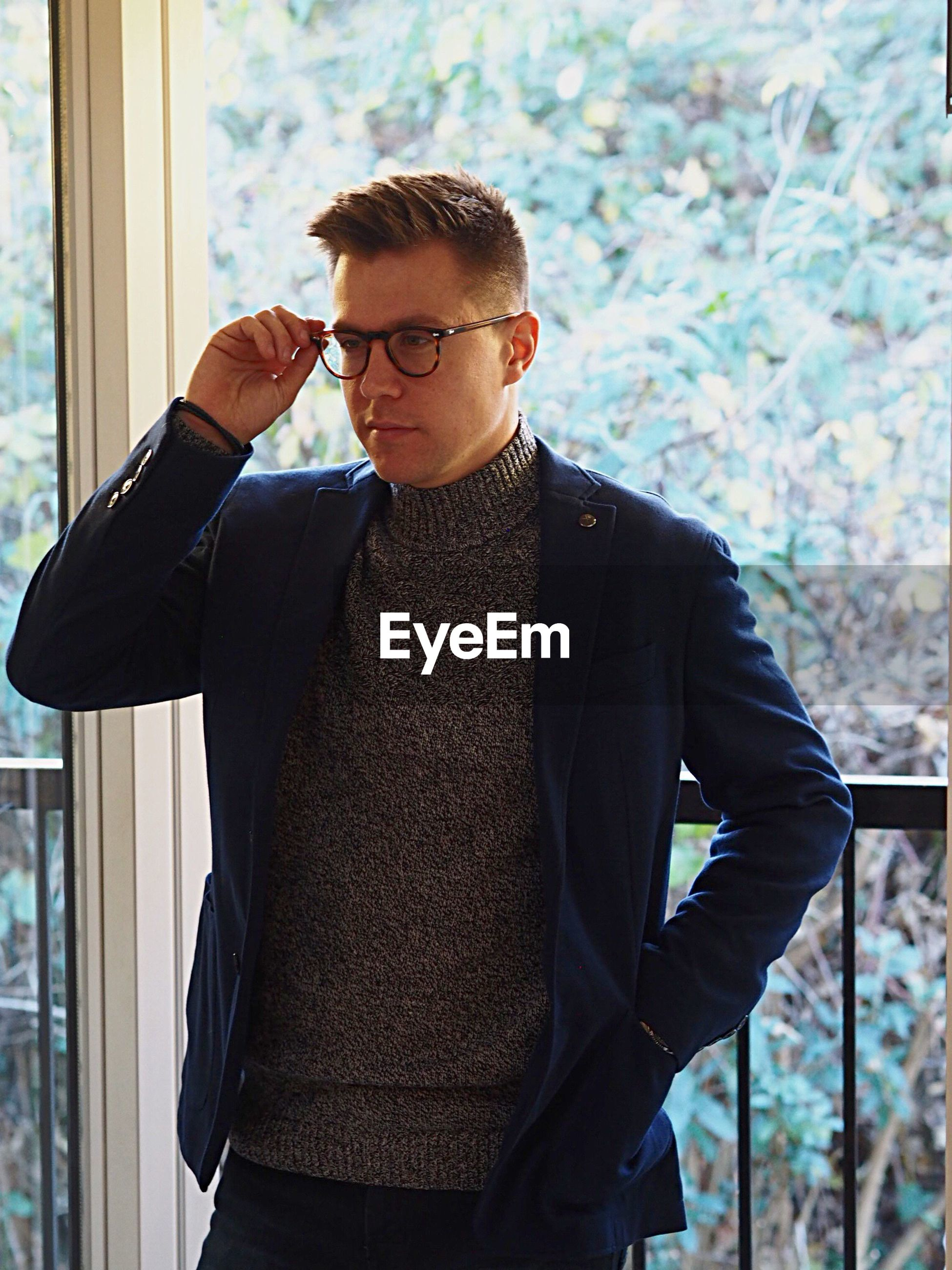 eyeglasses, one person, real people, young adult, standing, young men, businessman, fashion, front view, day, office, business, indoors, one man only, adult, people