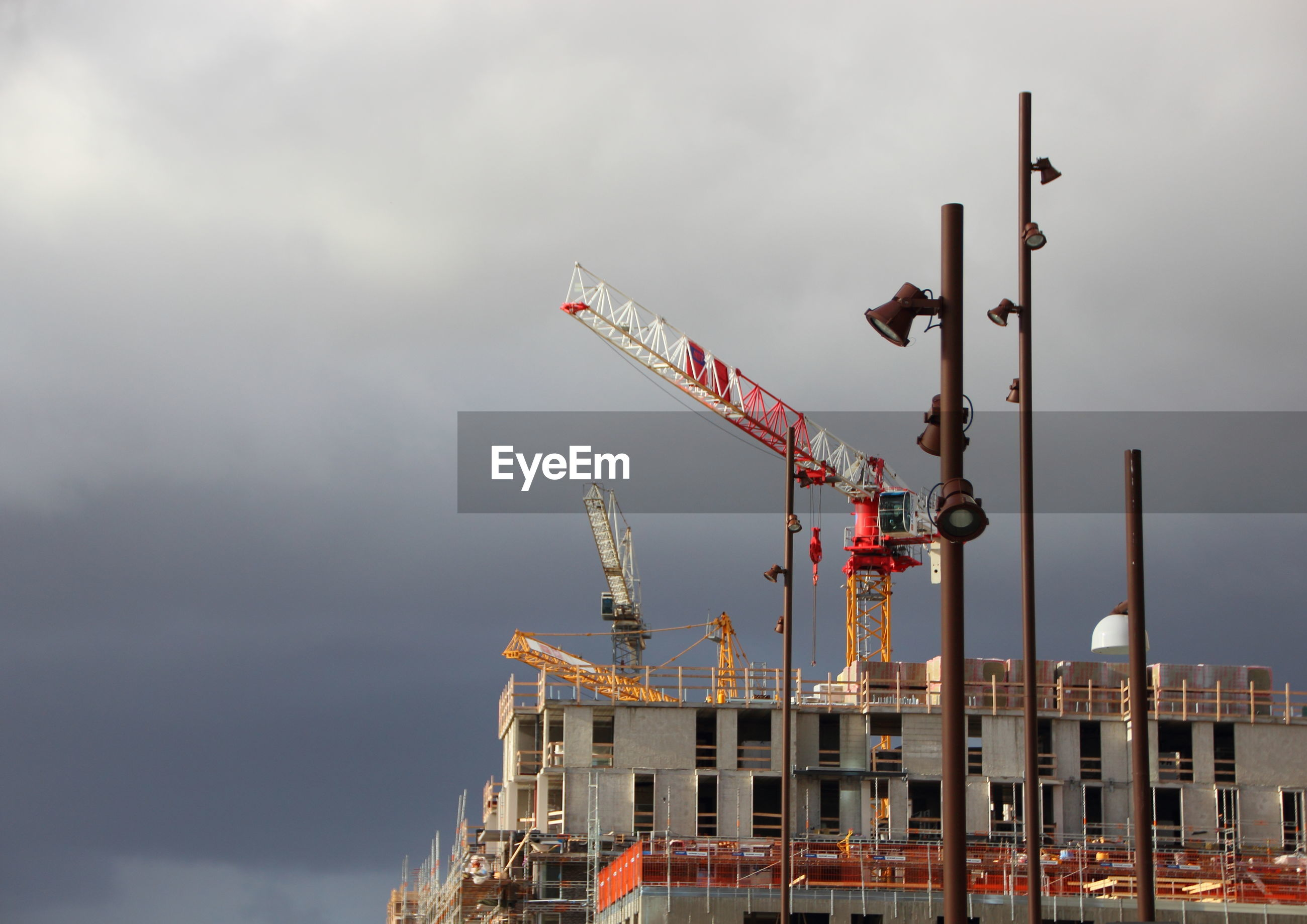 Low angle view of crane and building construction