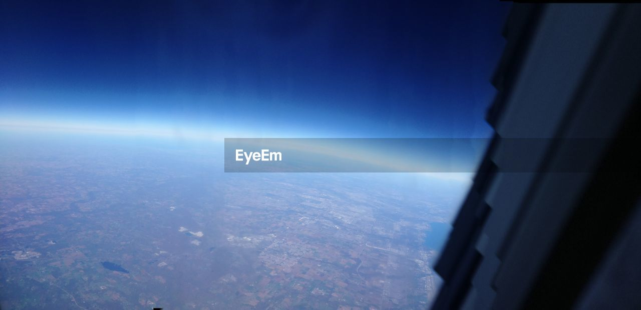 blue, nature, sky, aerial view, beauty in nature, scenics, window, no people, day, outdoors, close-up, astronomy, airplane wing