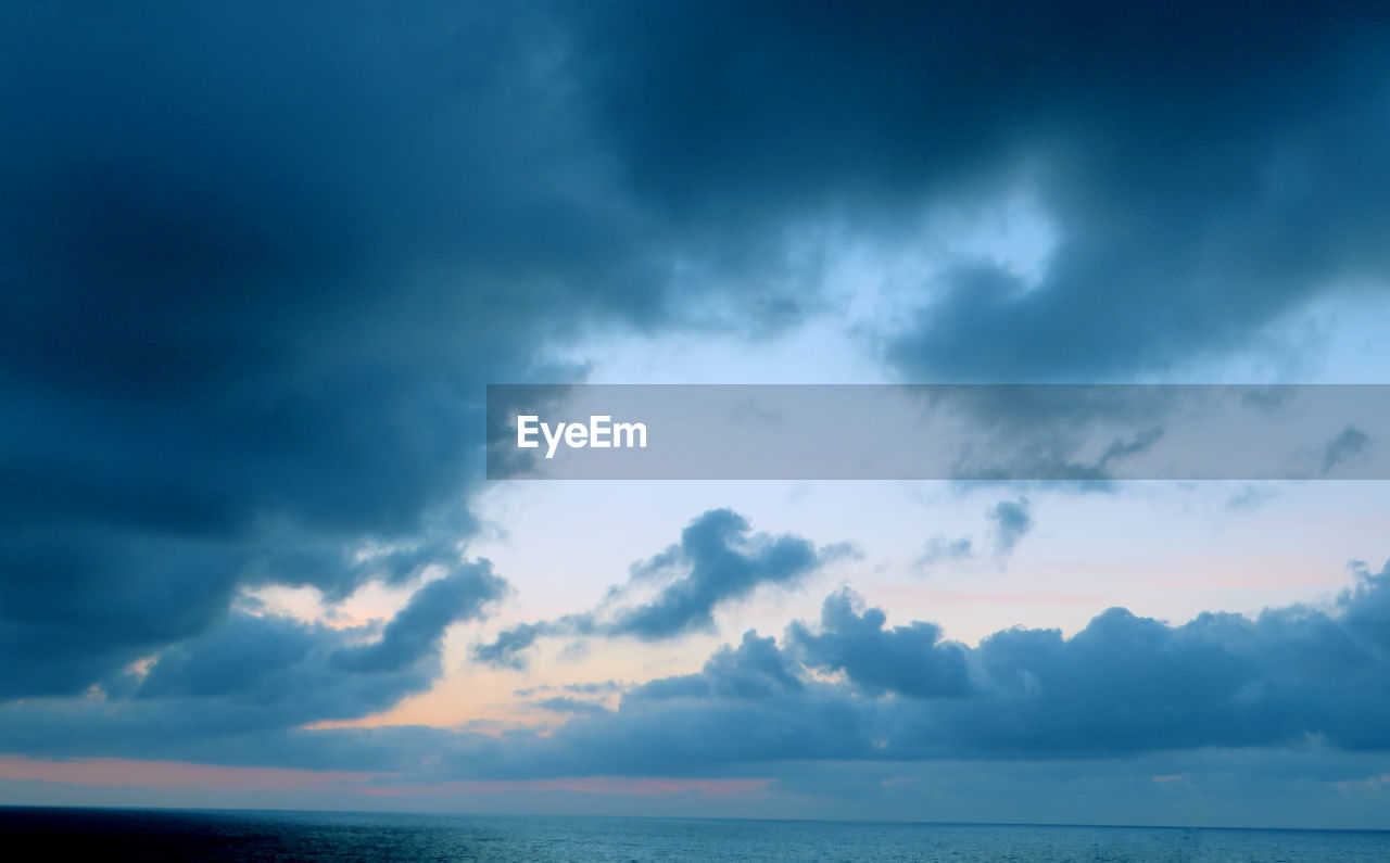 sky, cloud - sky, beauty in nature, scenics - nature, sea, tranquility, tranquil scene, water, horizon, horizon over water, nature, no people, idyllic, storm, dramatic sky, outdoors, overcast, sunset