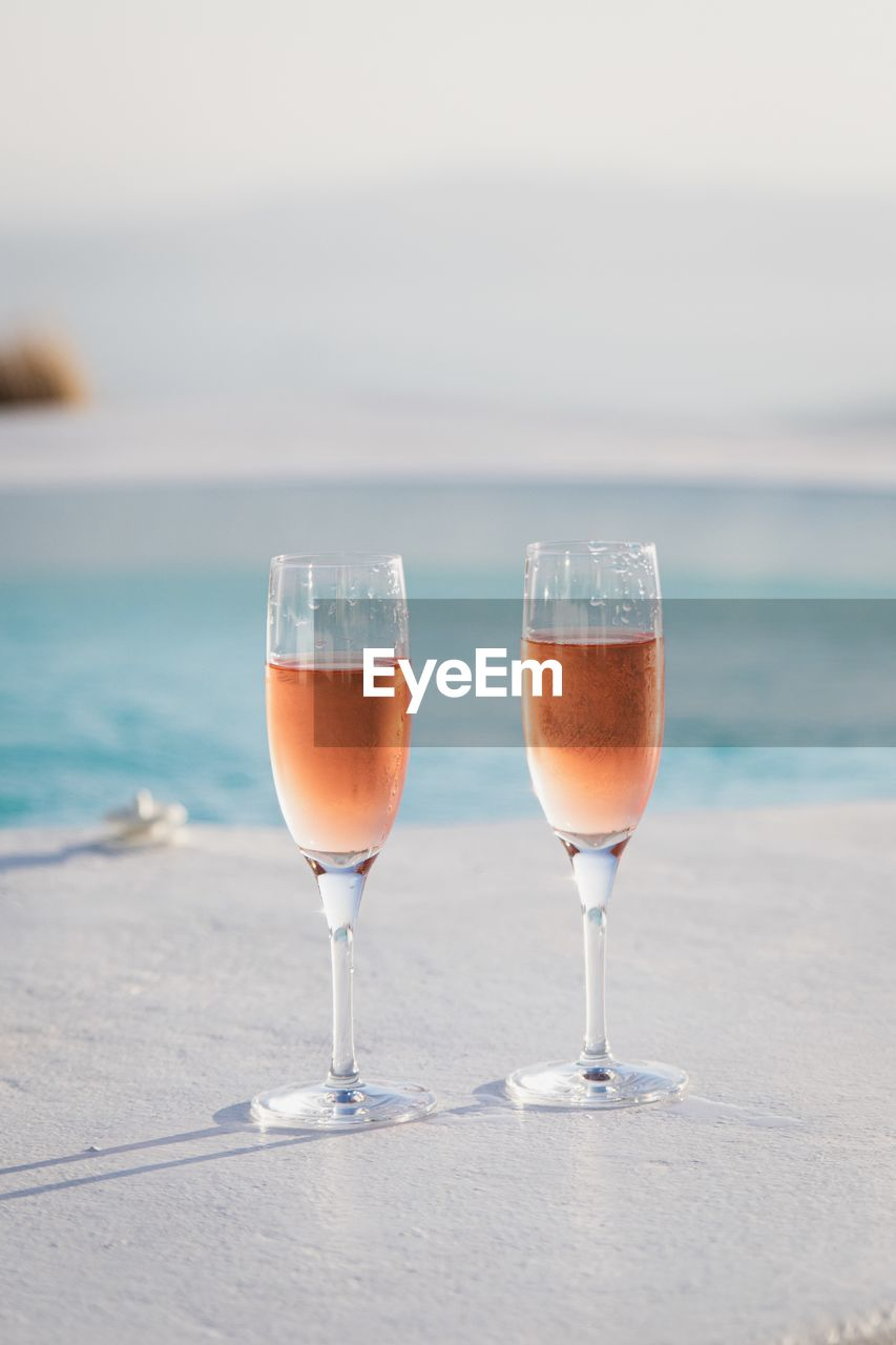 Drink in champagne flutes at poolside