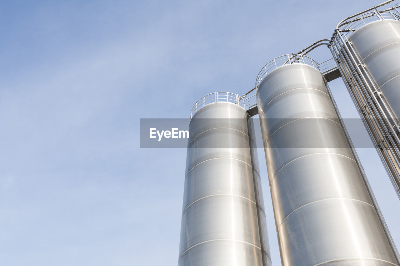 Low Angle View Of Storage Tank Against Sky