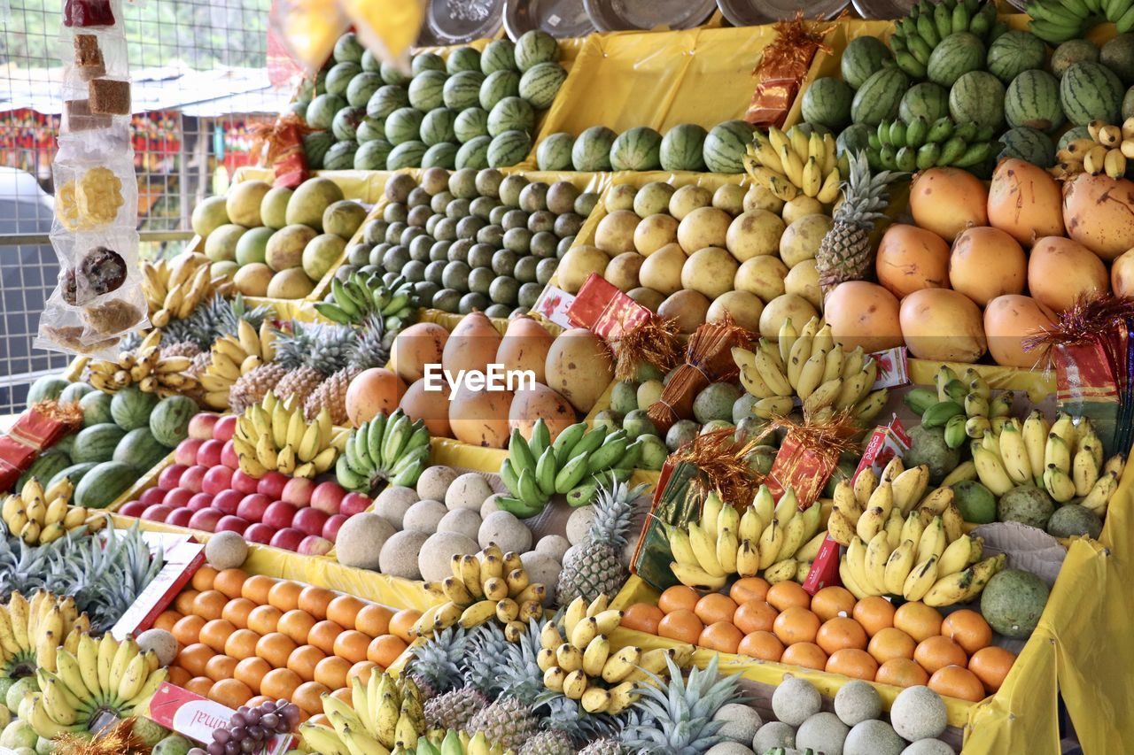 food, food and drink, choice, variation, healthy eating, fruit, retail, market, freshness, vegetable, wellbeing, market stall, large group of objects, abundance, tropical fruit, no people, pineapple, for sale, multi colored, banana, melon, retail display