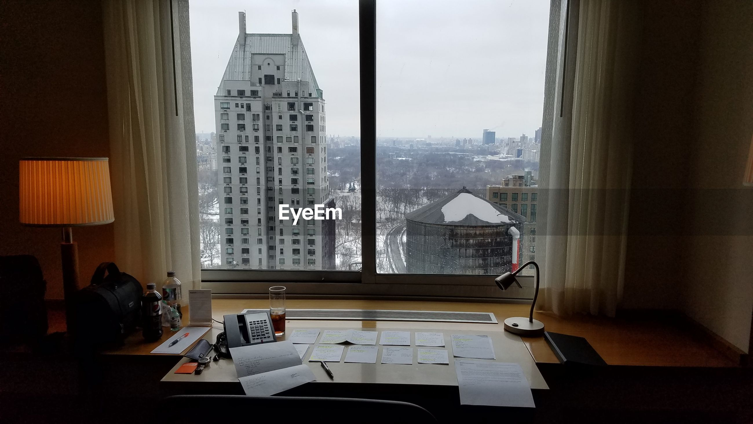 VIEW OF OFFICE BUILDINGS THROUGH WINDOW