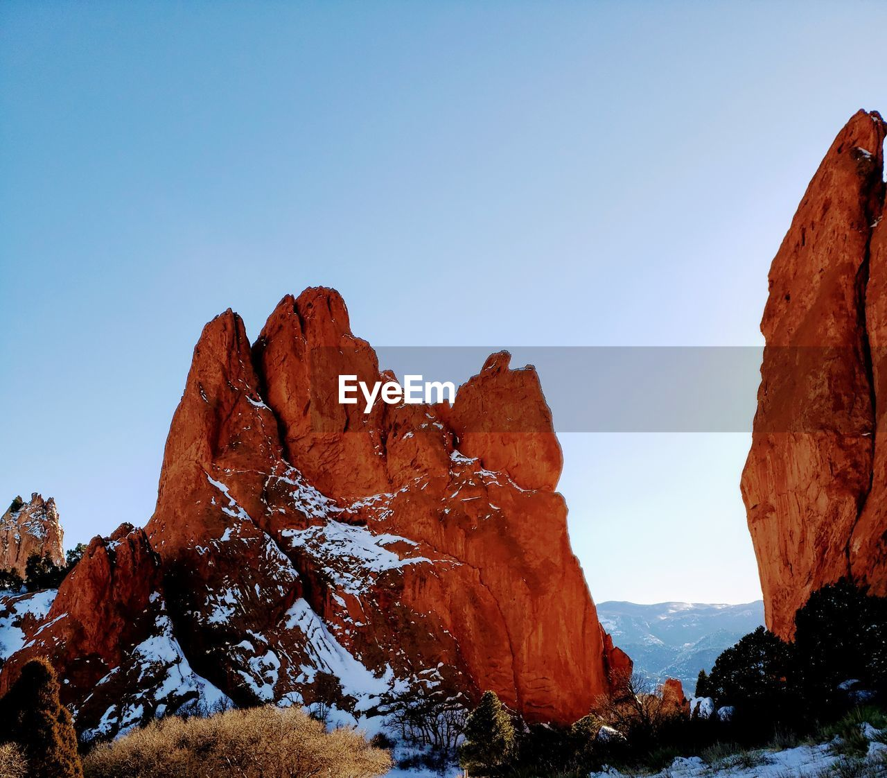sky, scenics - nature, beauty in nature, rock, clear sky, tranquil scene, mountain, tranquility, nature, rock - object, rock formation, non-urban scene, environment, no people, landscape, geology, mountain range, solid, copy space, day, outdoors, formation, mountain peak, eroded