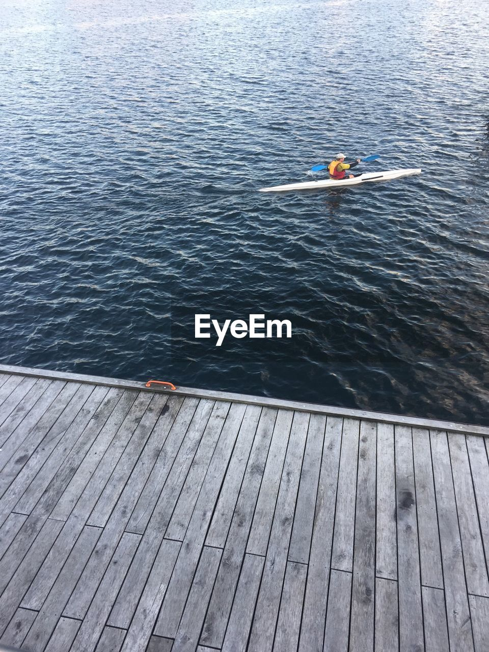 High angle view of man kayaking in lake