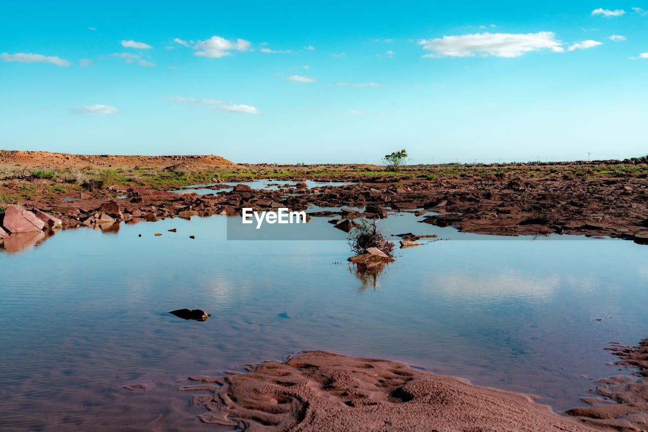 water, sky, tranquil scene, scenics - nature, tranquility, beauty in nature, nature, cloud - sky, solid, day, rock, non-urban scene, land, rock - object, no people, environment, landscape, blue, idyllic, outdoors