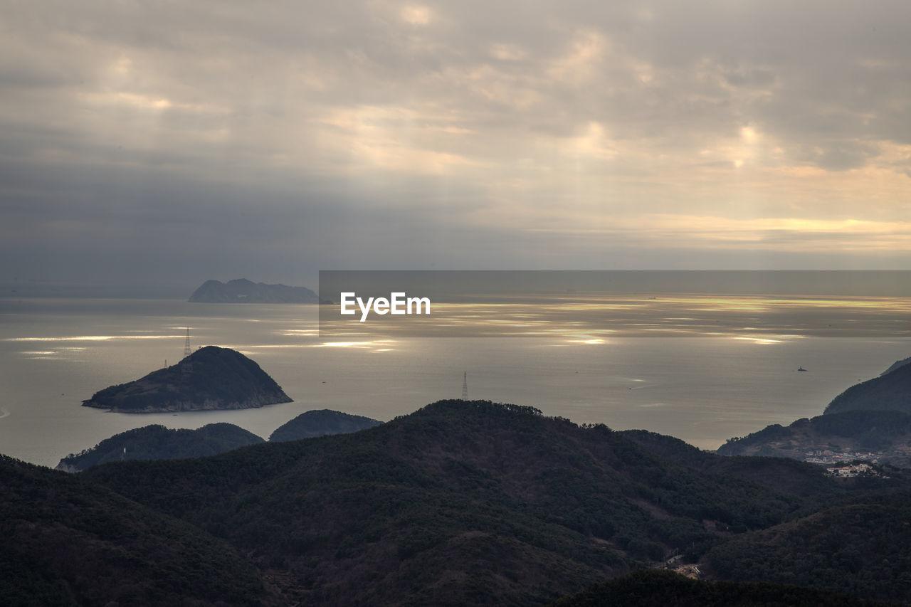 scenics - nature, sky, beauty in nature, cloud - sky, mountain, tranquility, tranquil scene, sunset, non-urban scene, environment, no people, mountain range, water, nature, landscape, idyllic, sea, rock, outdoors, mountain peak