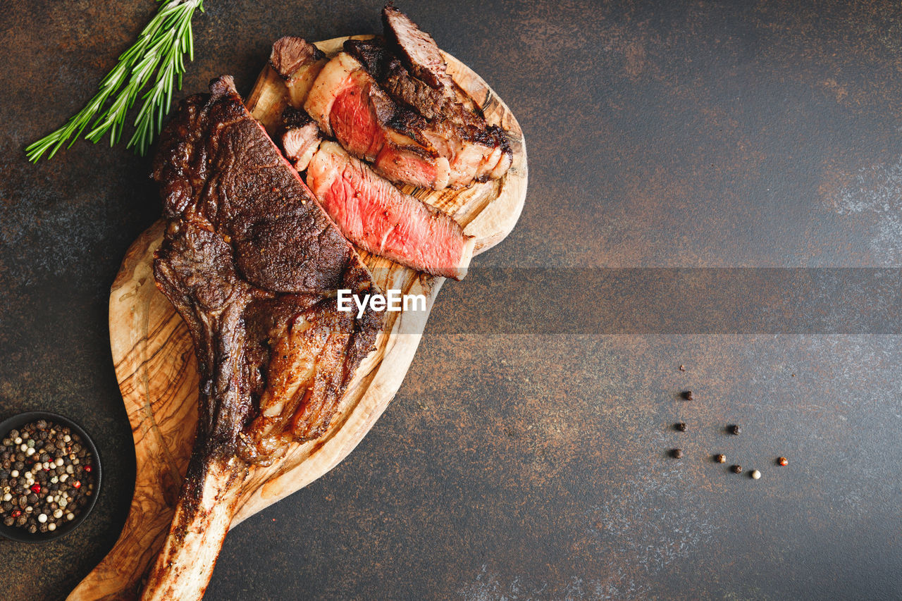 meat, food, food and drink, directly above, freshness, barbecue, roasted, ready-to-eat, red meat, grilled, no people, beef, steak, kitchen utensil, meal, still life, high angle view, vegetable, indoors, healthy eating, rib, garnish, dinner, lamb - meat
