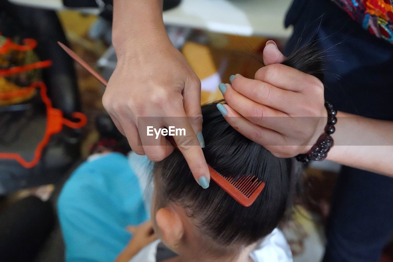 human hand, hand, women, real people, adult, two people, holding, focus on foreground, hairdresser, human body part, lifestyles, indoors, working, occupation, high angle view, human hair, customer, people, hair, skill, hairstyle, finger