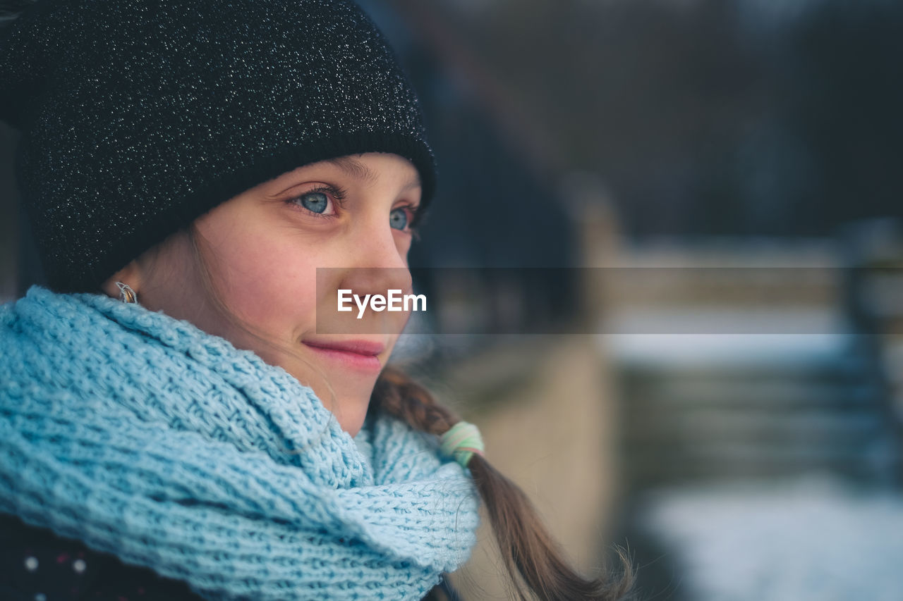 Close-Up Of Cute Girl In Warm Clothing