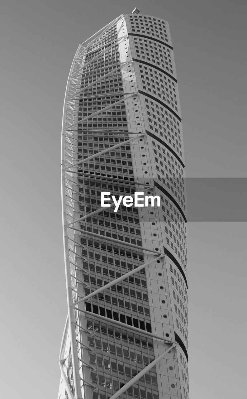 low angle view, building exterior, built structure, architecture, sky, building, tall - high, office building exterior, tower, clear sky, modern, city, no people, nature, office, skyscraper, day, outdoors, glass - material