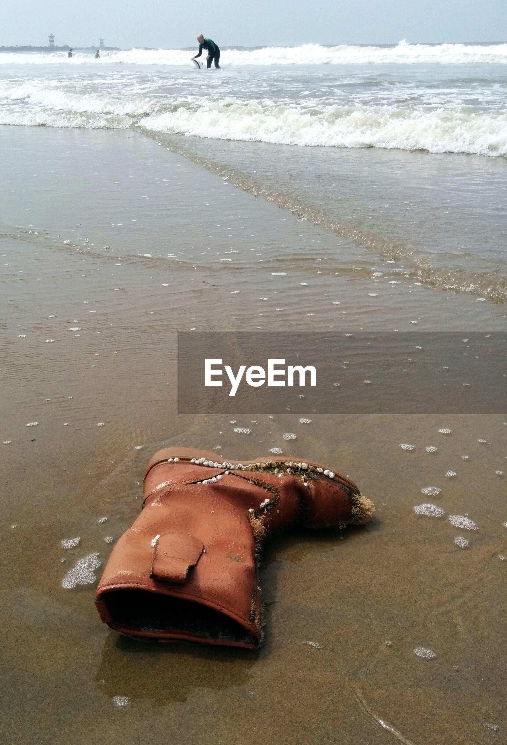 Abandoned shoe on beach