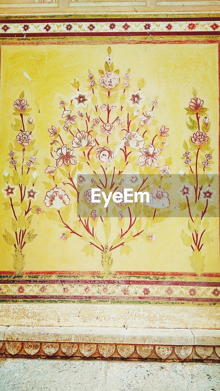 floral pattern, design, art and craft, pattern, yellow, close-up, architecture, no people, built structure, paint, day, full frame, building exterior, backgrounds, outdoors, flower