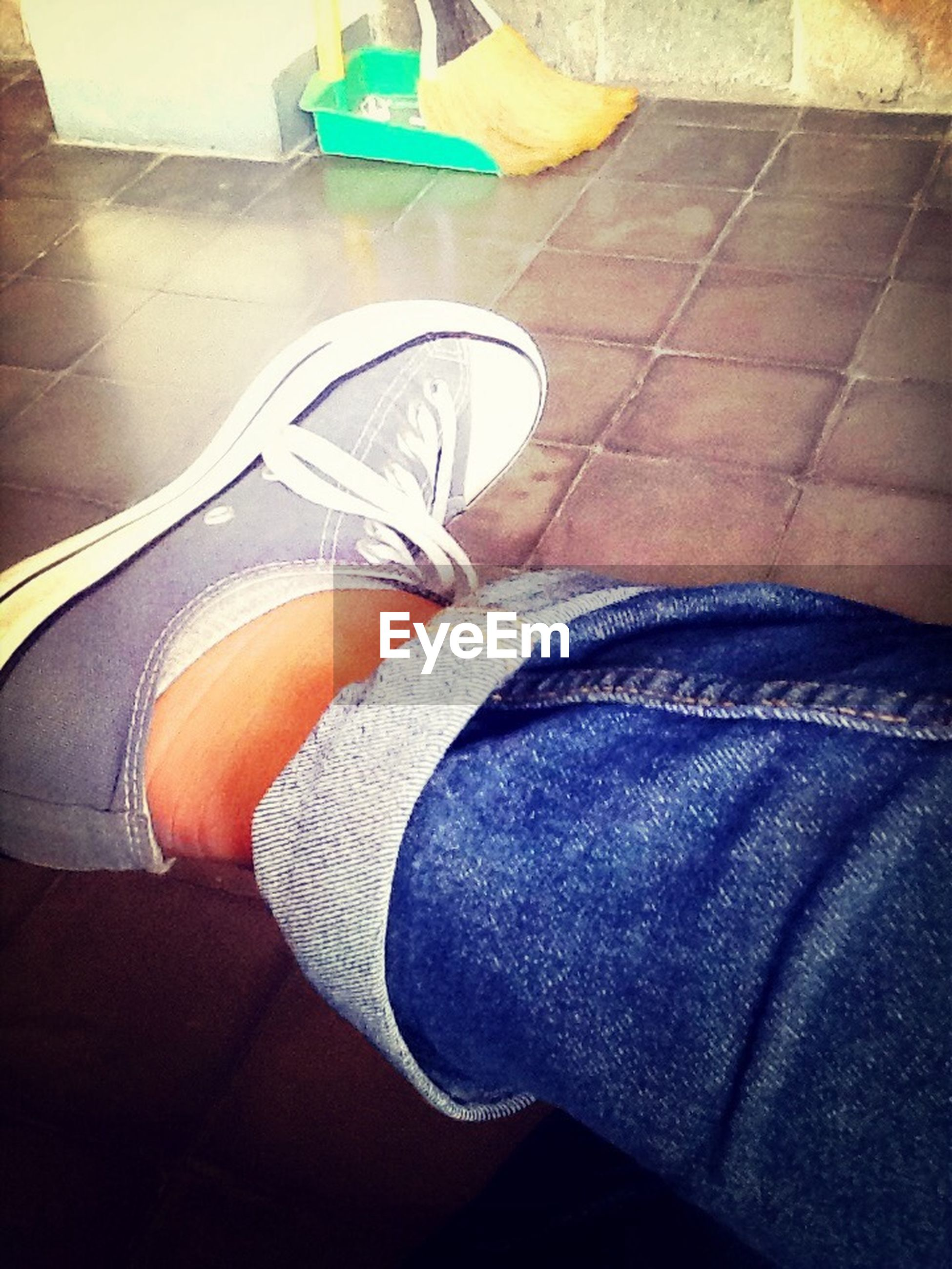 low section, person, shoe, jeans, personal perspective, high angle view, lifestyles, blue, human foot, casual clothing, standing, footwear, indoors, sitting, relaxation, men, leisure activity