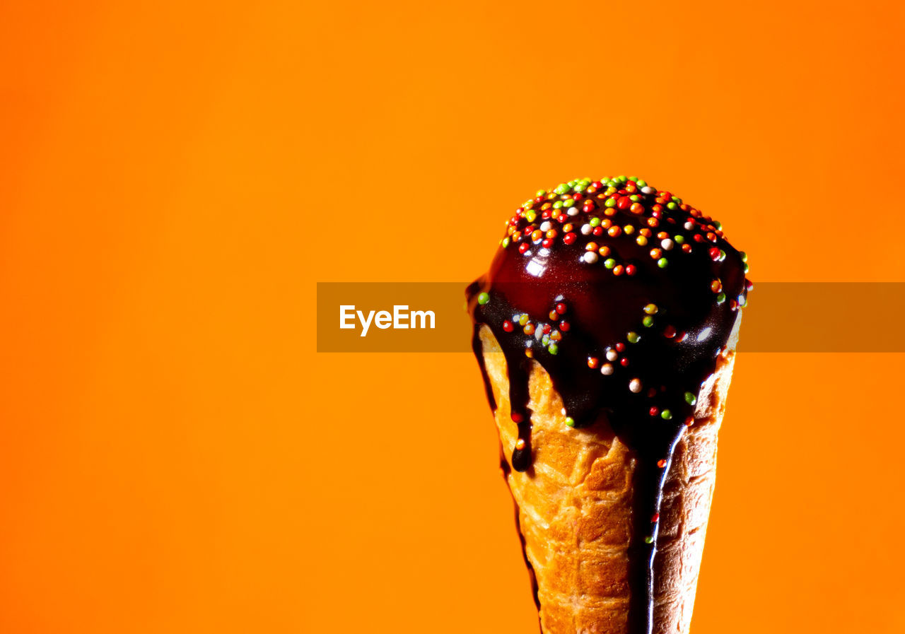 sweet food, sweet, food, indulgence, food and drink, colored background, close-up, studio shot, dessert, unhealthy eating, sprinkles, still life, temptation, indoors, no people, freshness, ready-to-eat, orange background, ice cream, copy space, snack