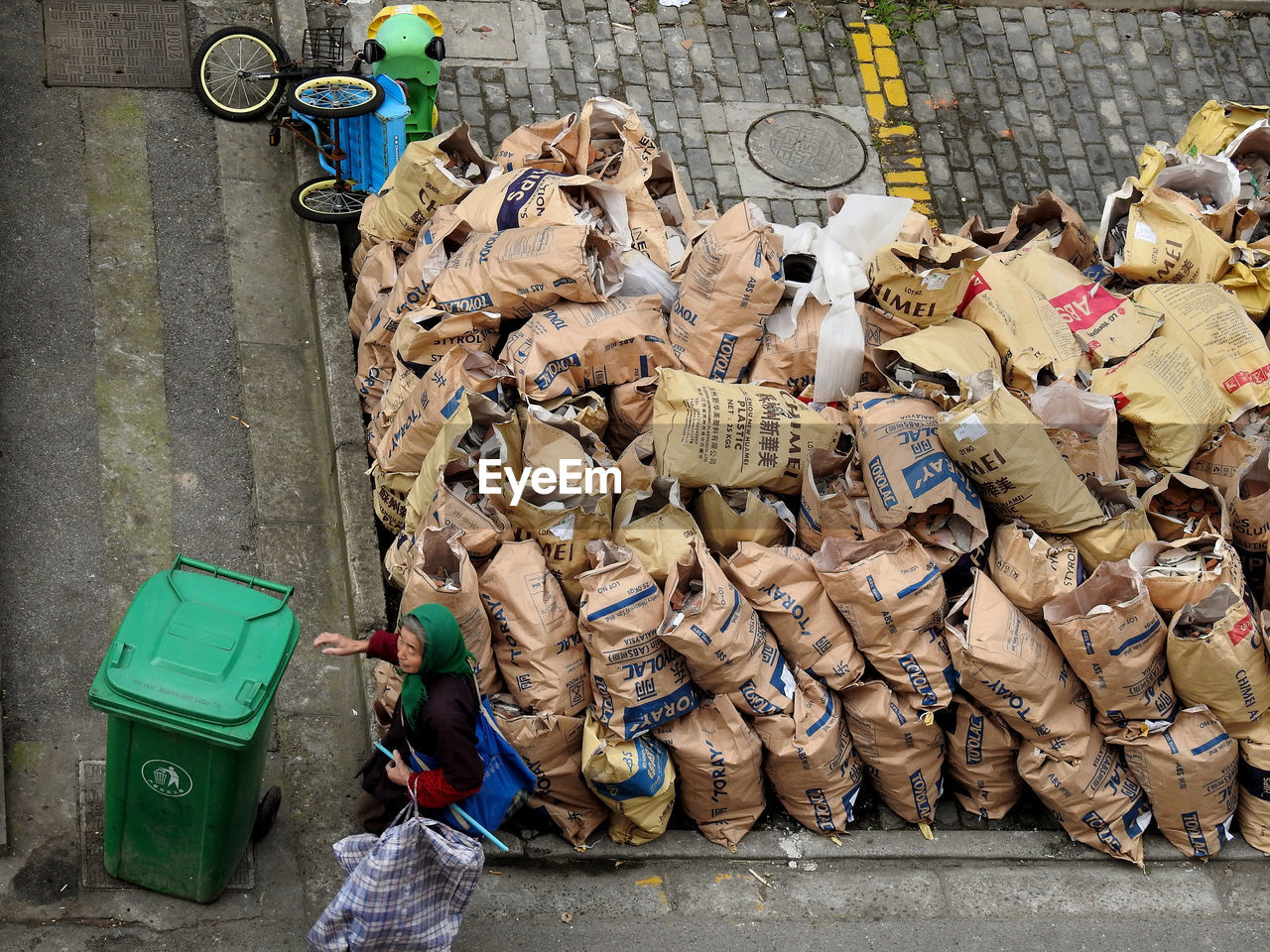 garbage, environmental conservation, environmental issues, large group of objects, responsibility, waste management, collection, day, outdoors, social issues, stack, recycling center, men, environmentalist, people