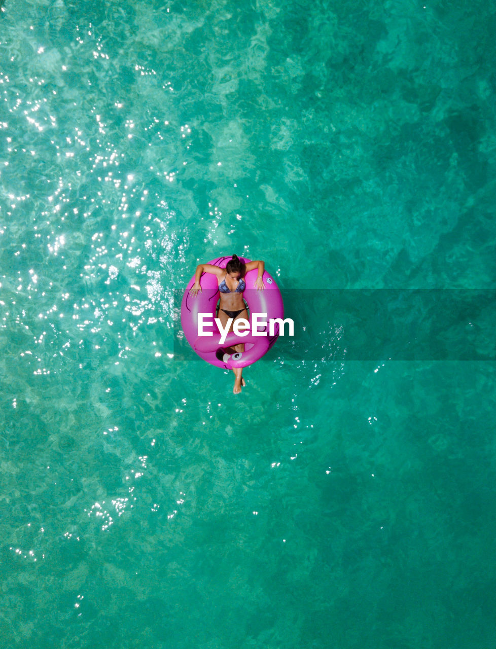 HIGH ANGLE VIEW OF BOY SWIMMING IN WATER
