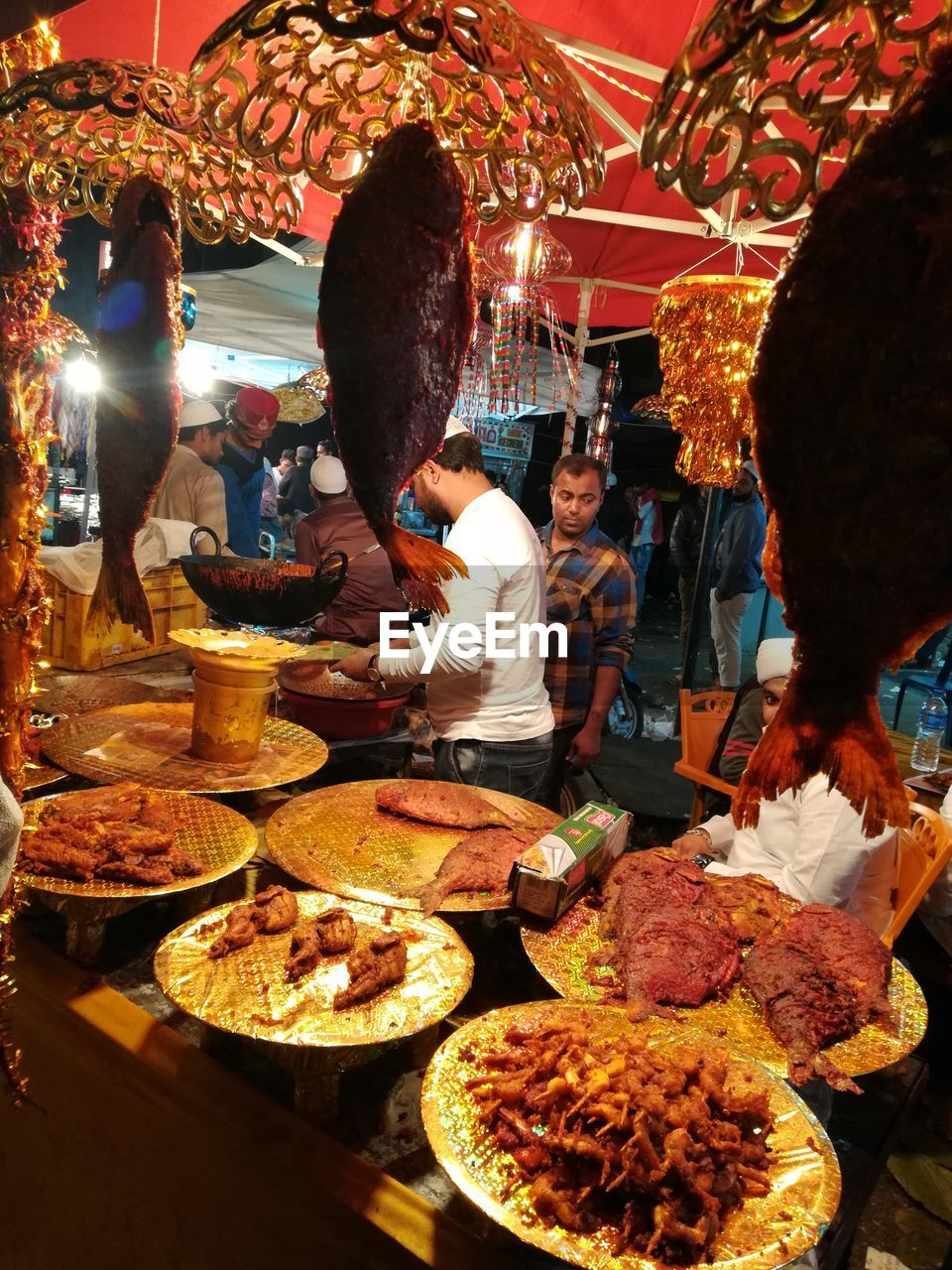 food and drink, food, retail, business, market, real people, choice, group of people, market stall, variation, men, for sale, women, adult, indoors, freshness, buying, medium group of people, meat, small business, consumerism, sale, street market