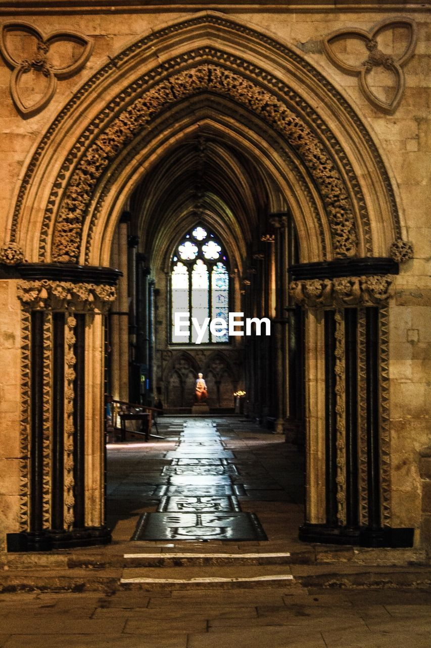 arch, architecture, built structure, indoors, history, day, place of worship, no people