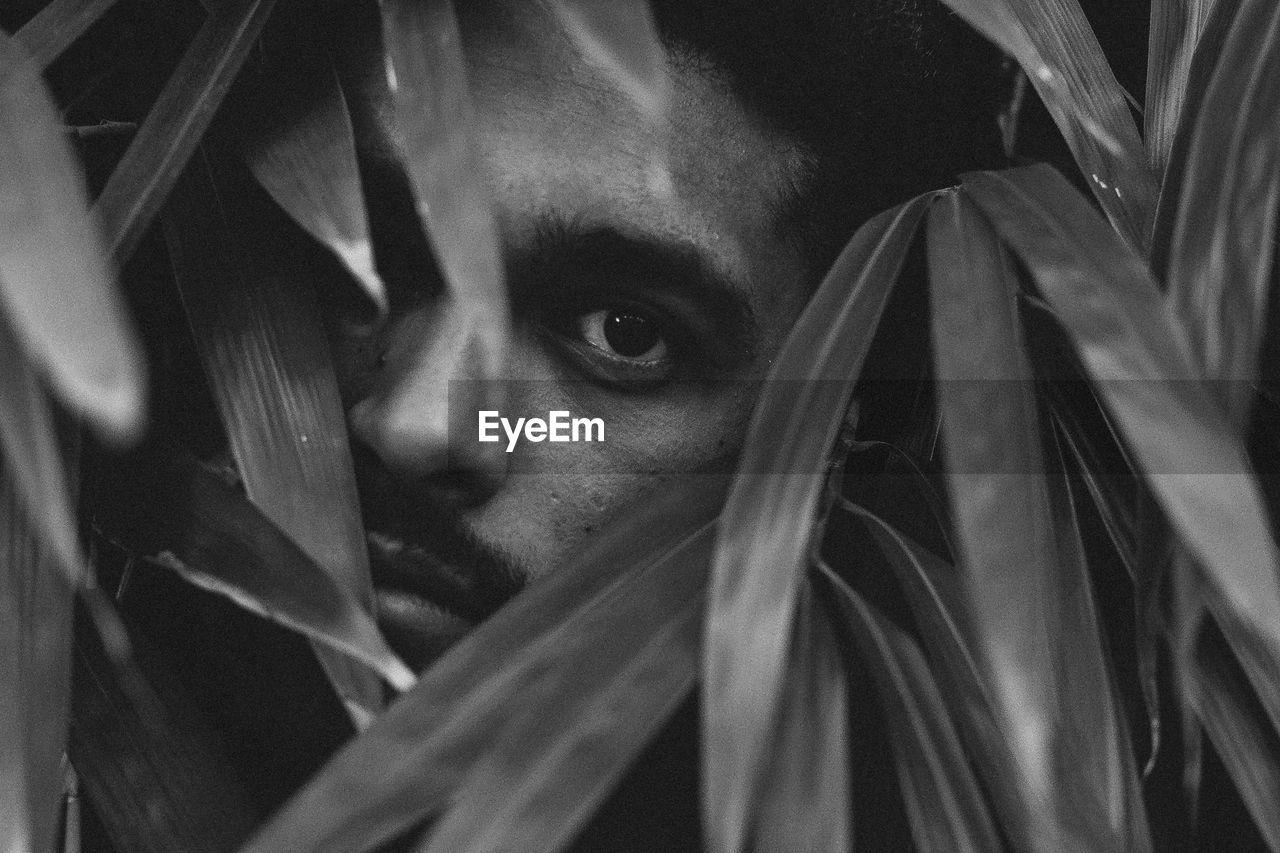 Close-Up Portrait Of Man Amidst Leaves