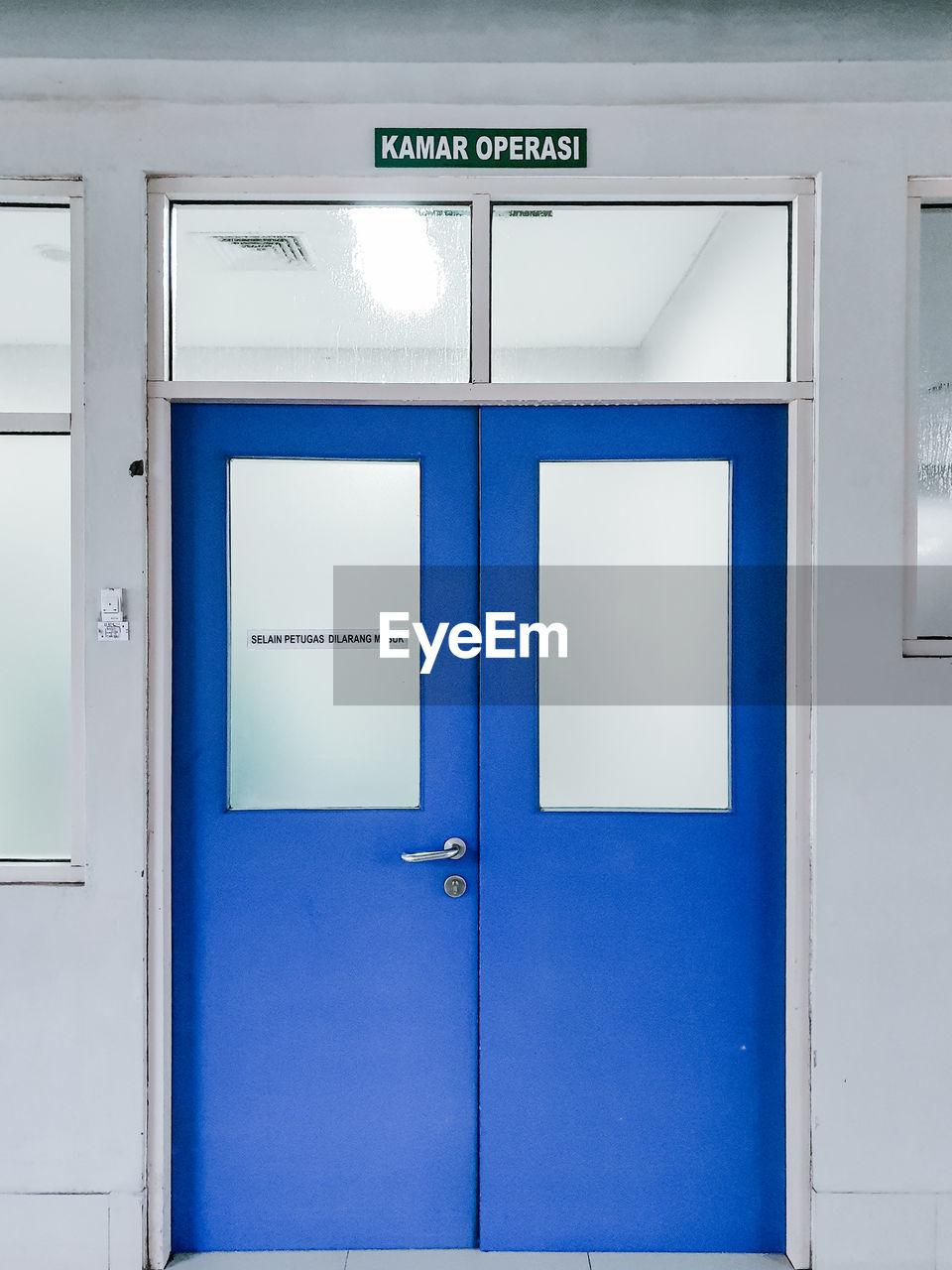 Text on blue door