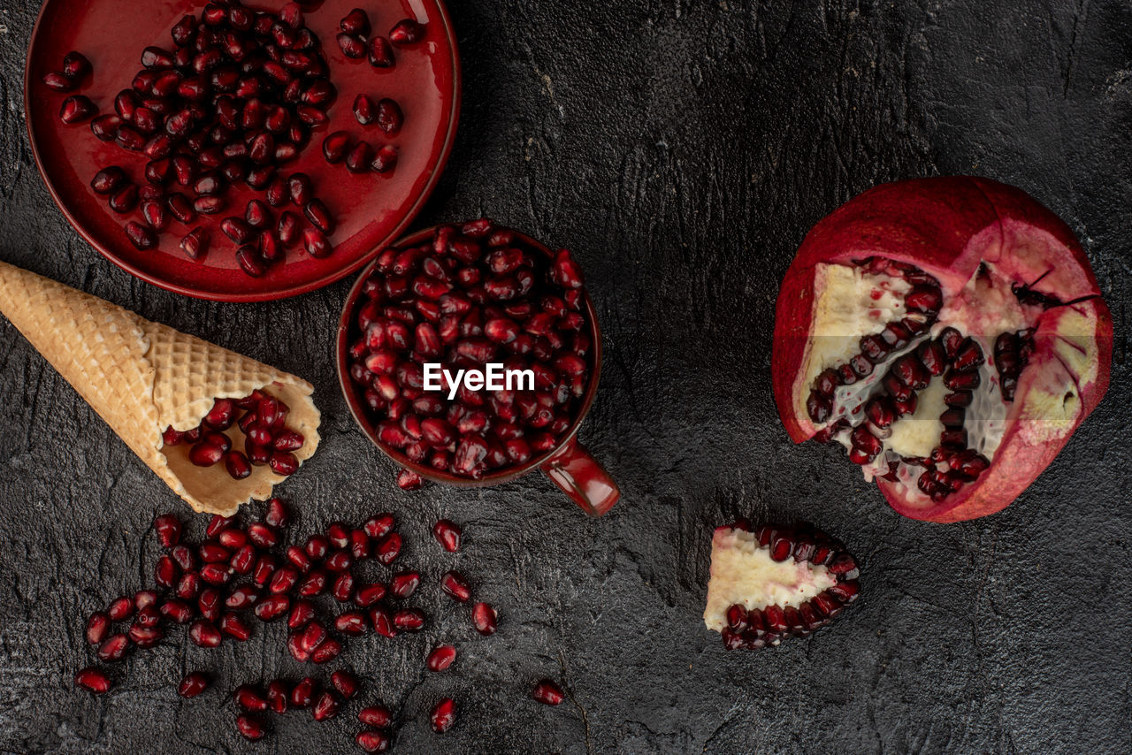 healthy eating, food, fruit, food and drink, freshness, pomegranate, wellbeing, seed, red, pomegranate seed, no people, directly above, slice, healthy lifestyle, berry fruit, cross section, indoors, still life, high angle view, table, ripe, antioxidant, chopped