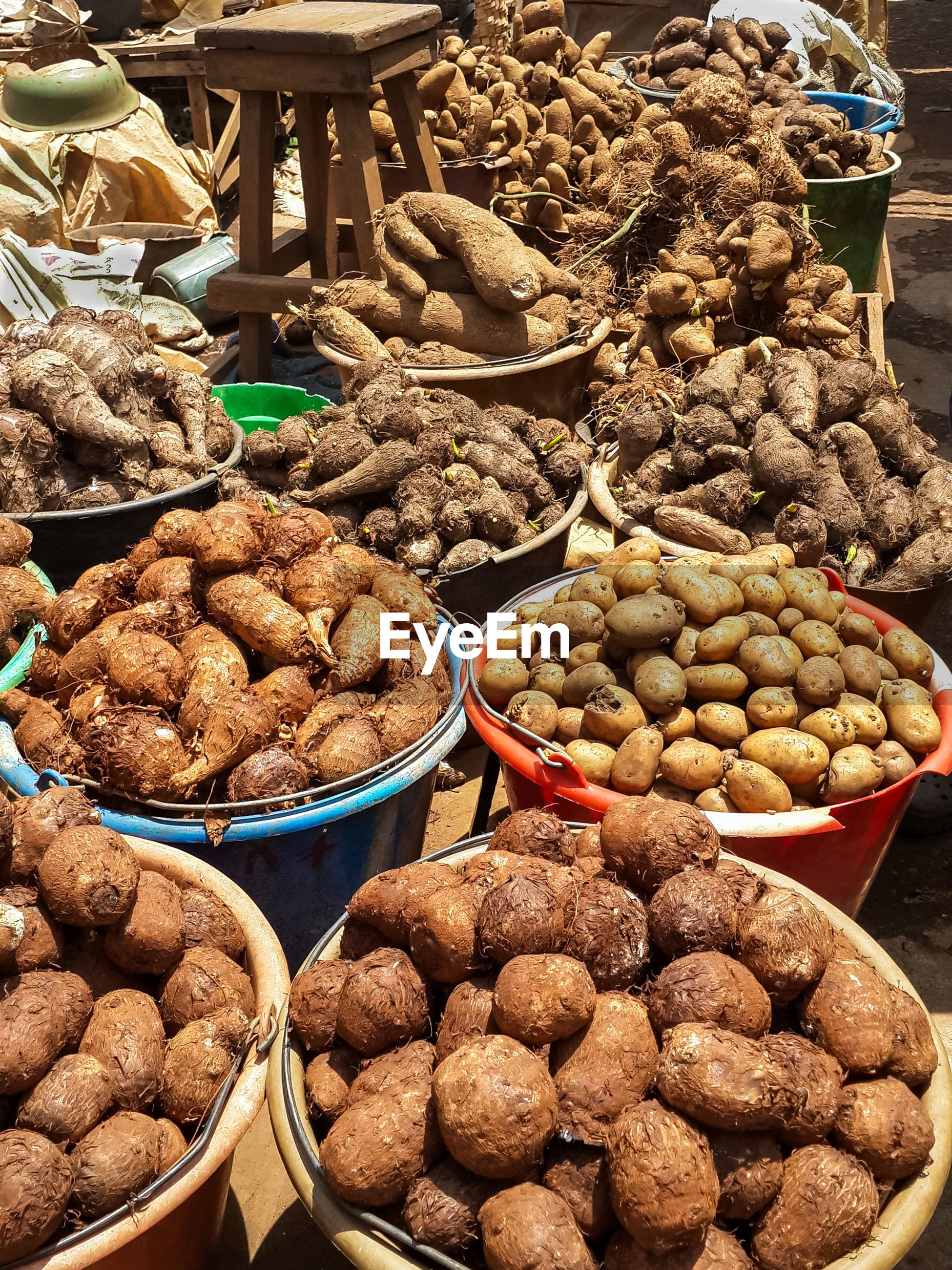 Close-up of potatoes and other root vegetables for sale at market stall, bamenda, cameroon
