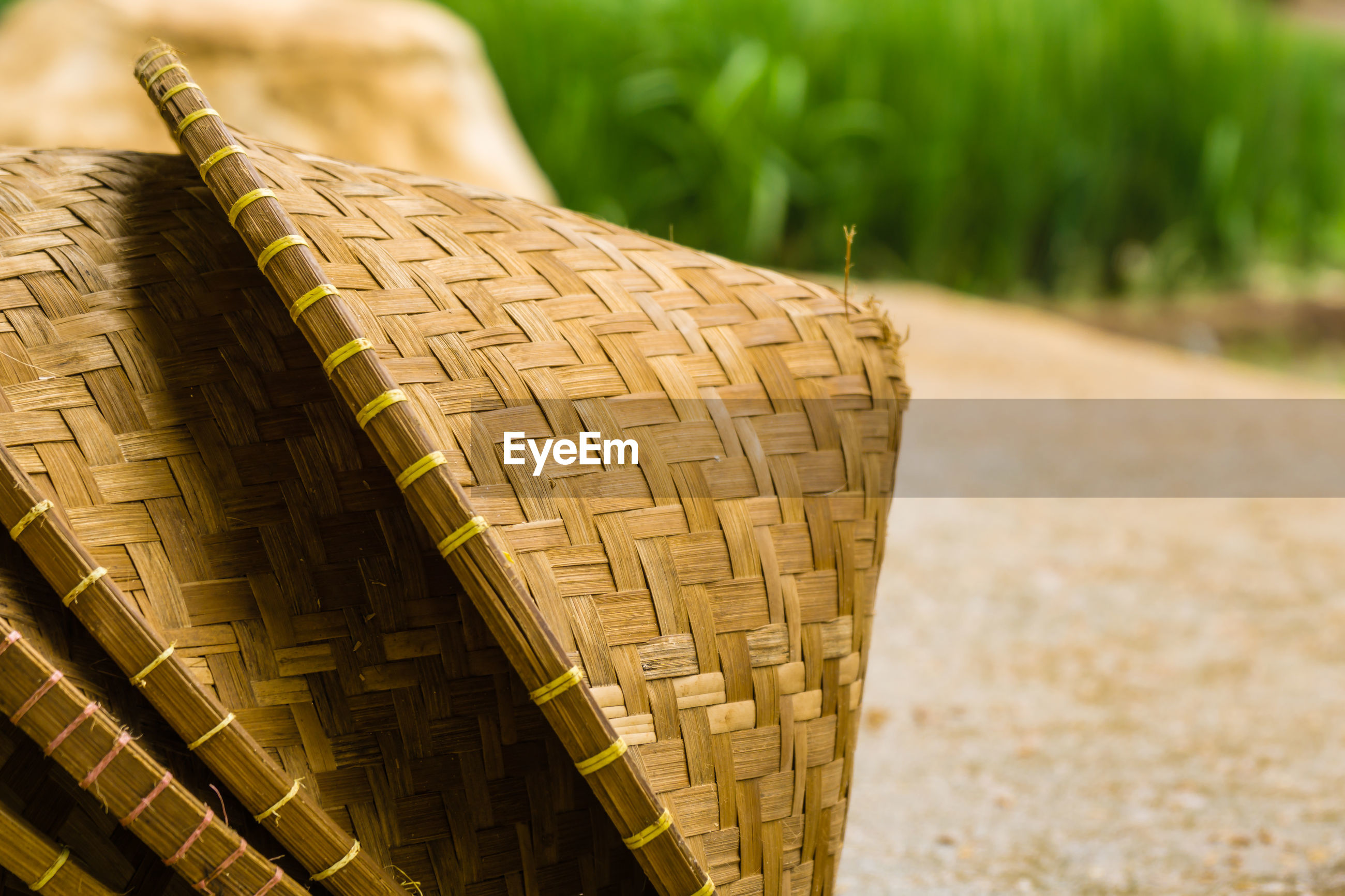 CLOSE-UP OF BASKET IN FIELD