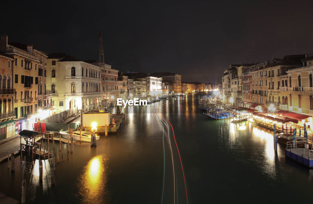 Light Trail In Grand Canal Against Sky At Night