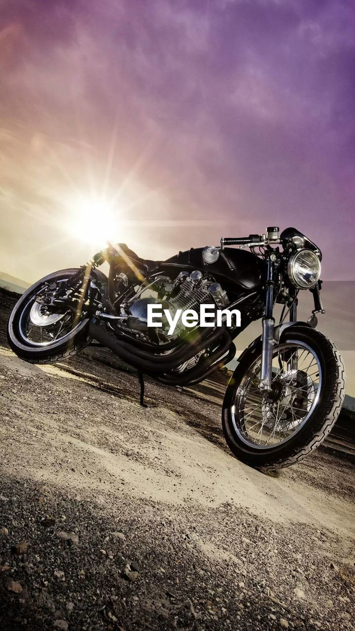 transportation, sky, mode of transportation, land vehicle, sun, sunlight, motorcycle, lens flare, nature, road, outdoors, motor vehicle, city, travel, street, car, sunbeam, one person, bicycle, bright, wheel, brightly lit