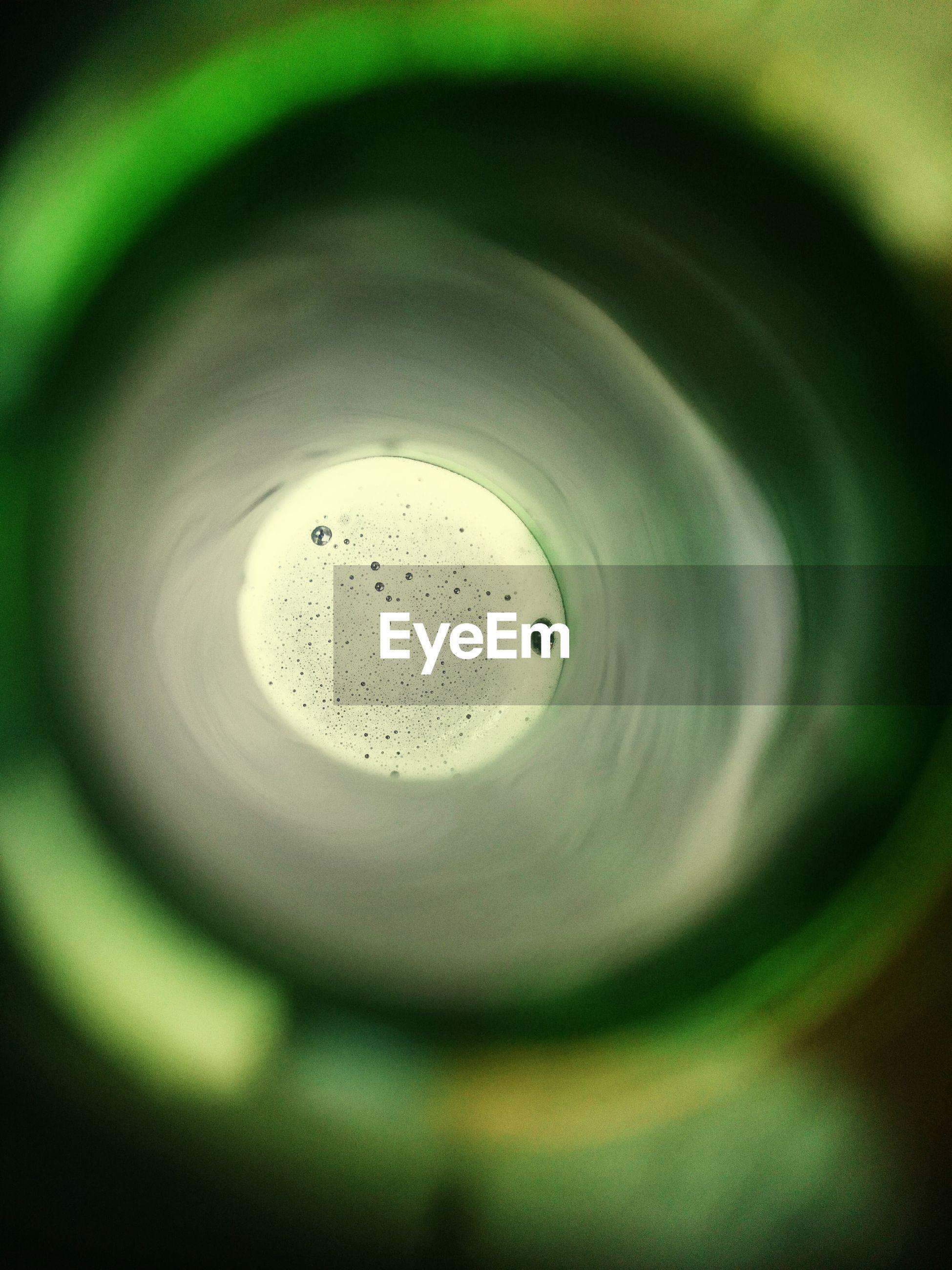 Close-up of green beer bottle