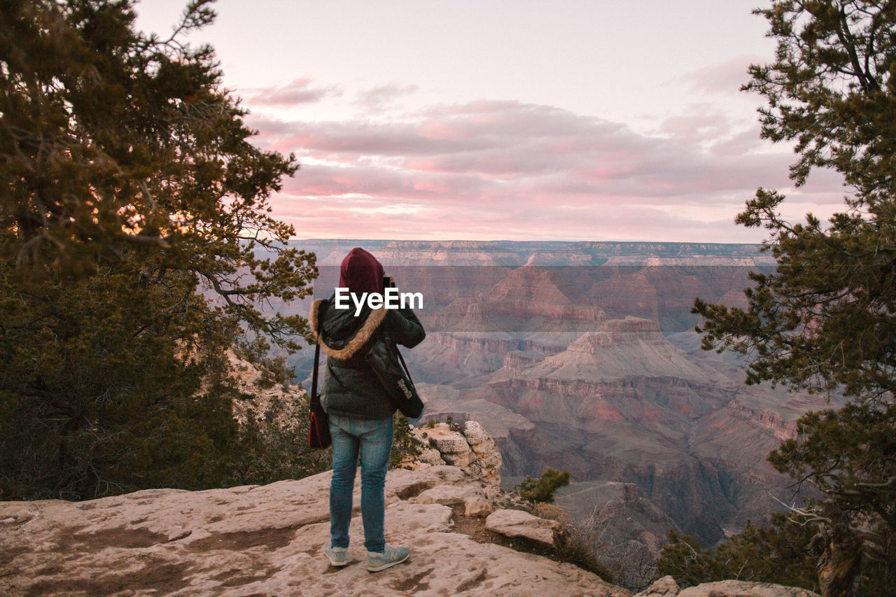 Rear View Of Person Standing Against Grand Canyon National Park