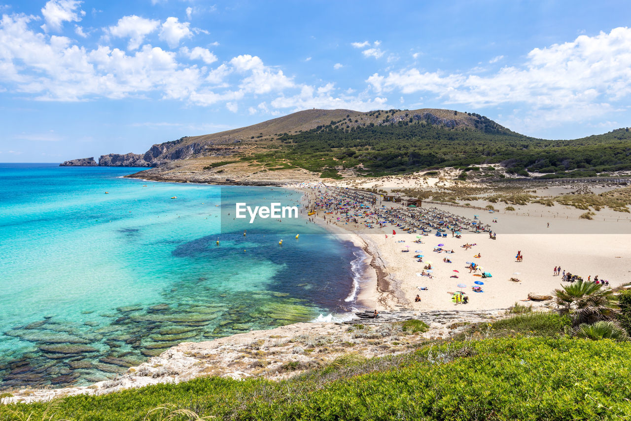 water, sea, land, beach, beauty in nature, sky, scenics - nature, cloud - sky, nature, tranquil scene, day, tranquility, mountain, incidental people, non-urban scene, idyllic, travel, holiday, trip, outdoors, turquoise colored