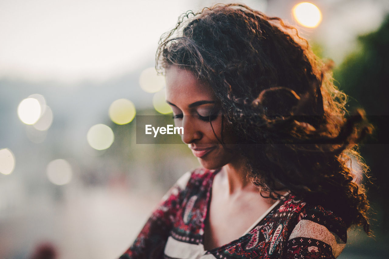 Close-Up Of Young Woman Smiling During Sunset