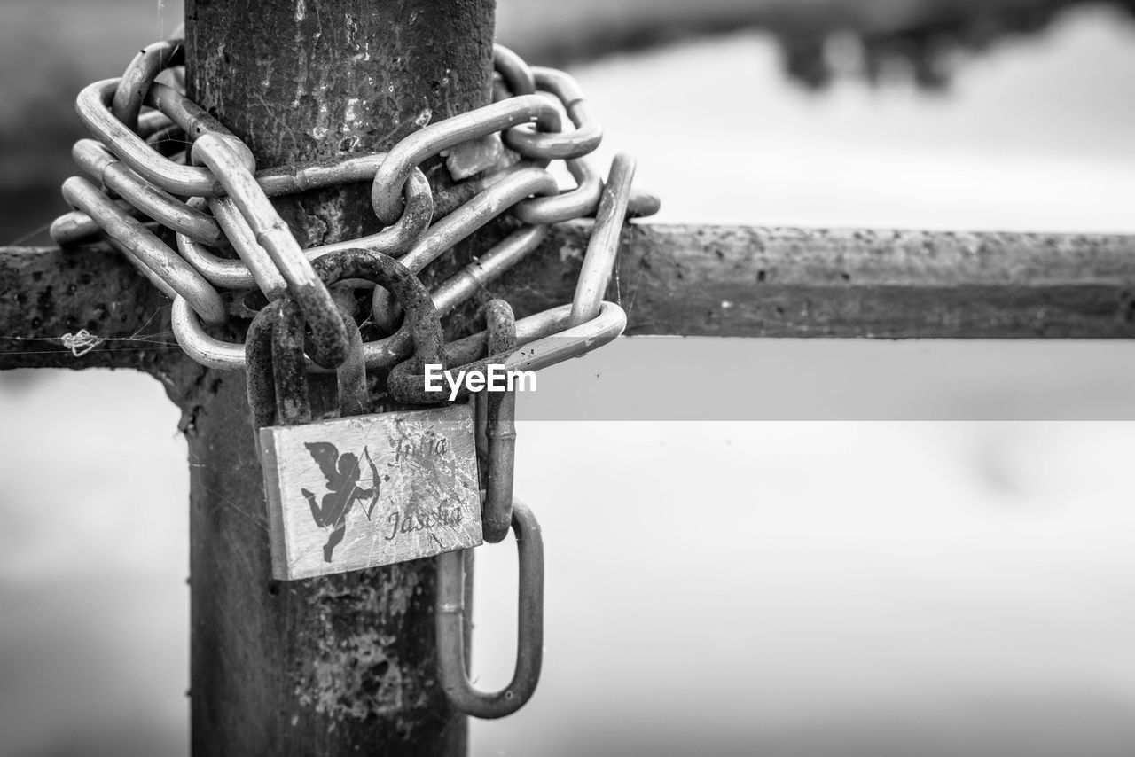 Chain With Padlock On Fence