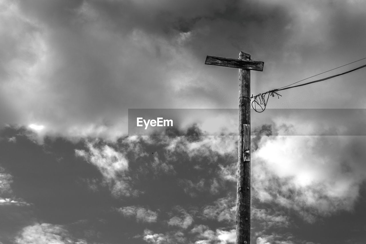 cloud - sky, sky, low angle view, nature, outdoors, no people, day, technology, pole, communication, electricity, overcast, silhouette, tall - high, sign, cable, metal, beauty in nature, lighting equipment, power supply, electrical equipment