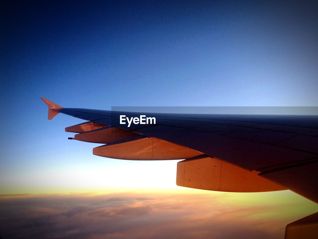 blue, airplane, journey, flying, nature, no people, sky, transportation, outdoors, airplane wing, beauty in nature, air vehicle, aircraft wing, scenics, landscape, day