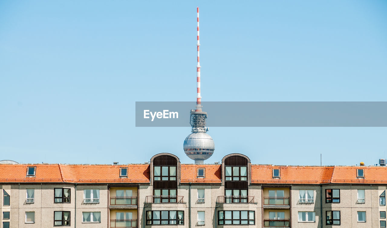Low angle view of fernsehturm against clear sky
