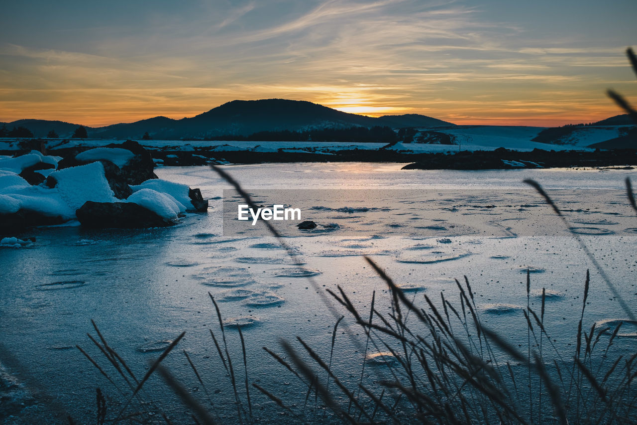 sky, water, sunset, scenics - nature, beauty in nature, tranquil scene, tranquility, cloud - sky, nature, mountain, winter, cold temperature, frozen, non-urban scene, snow, idyllic, land, no people, ice