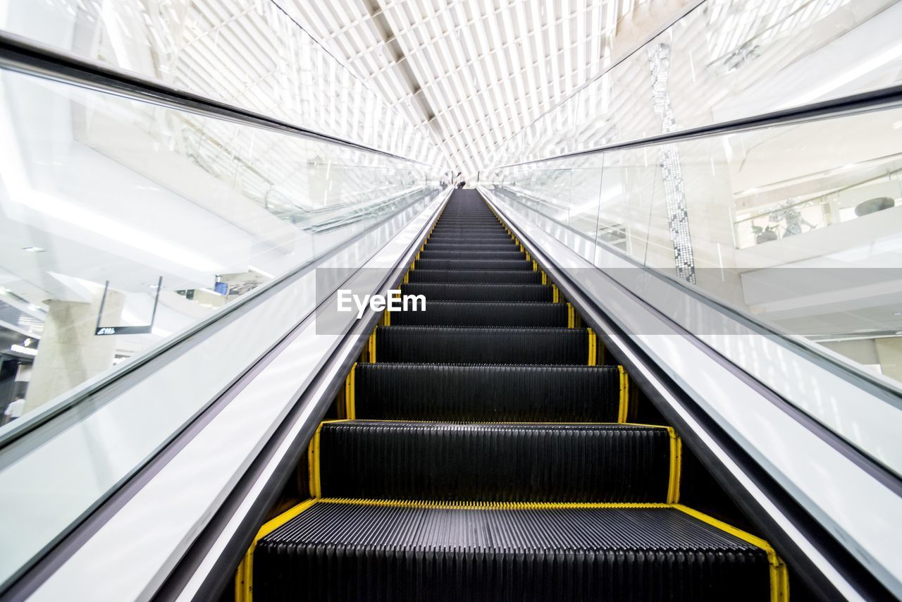 Low Angle View Of Escalator In Modern Building