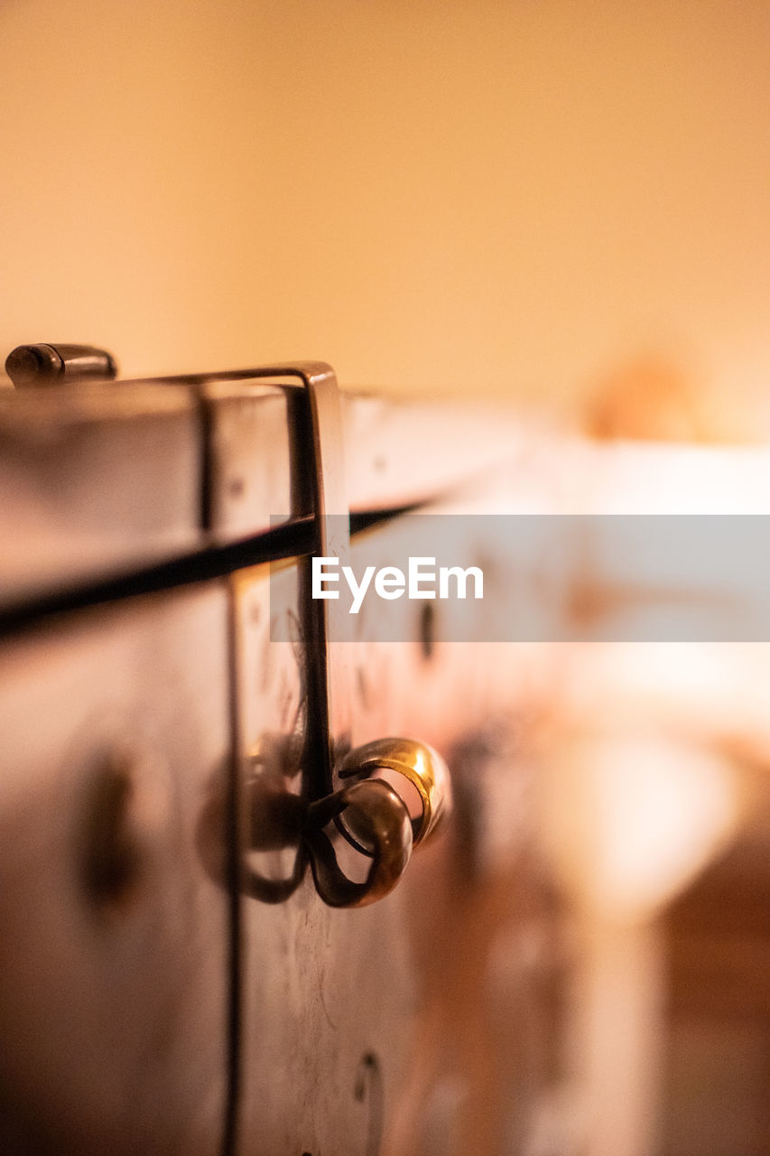 close-up, metal, no people, safety, indoors, security, selective focus, focus on foreground, old, protection, door, entrance, lock, knob, wood - material, technology, orange color, doorknob