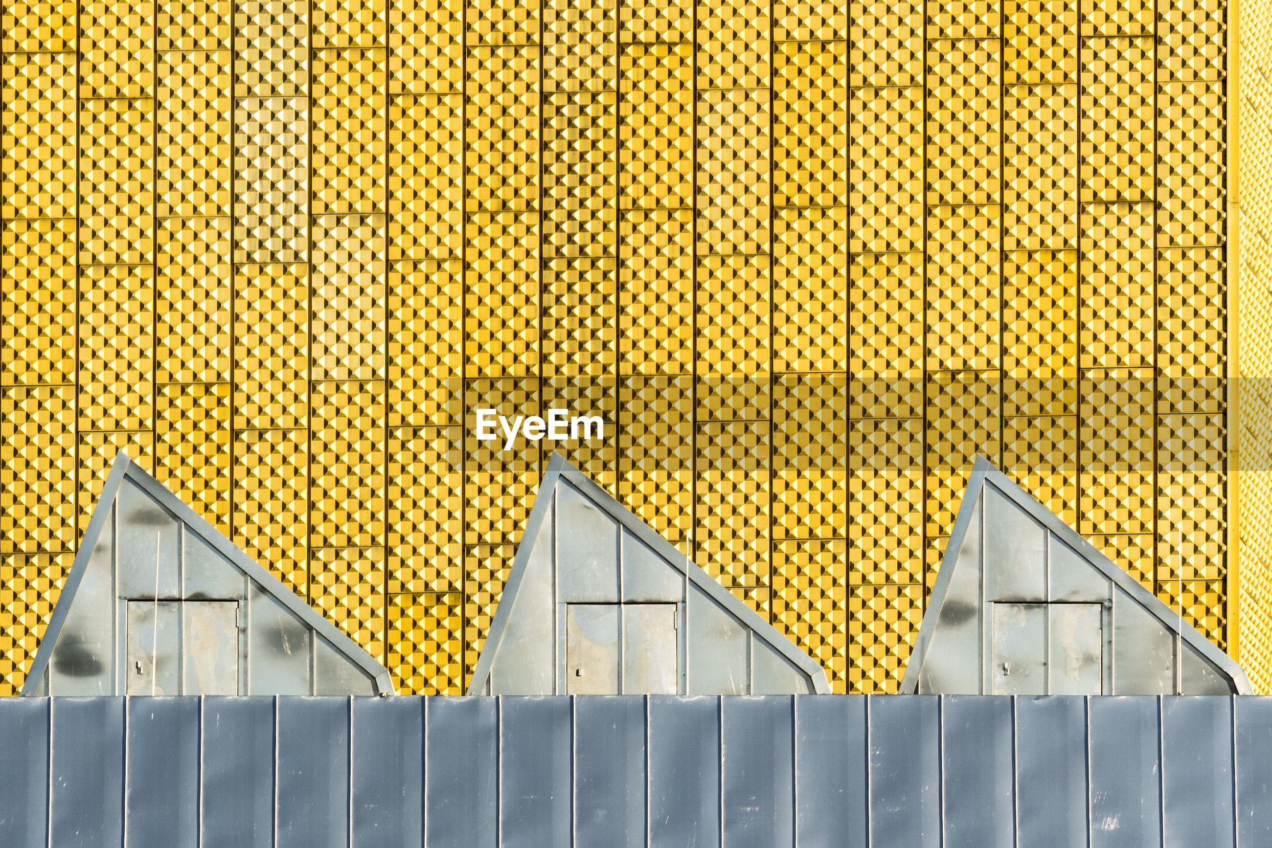 built structure, architecture, yellow, building exterior, outdoors, no people, day, corrugated iron