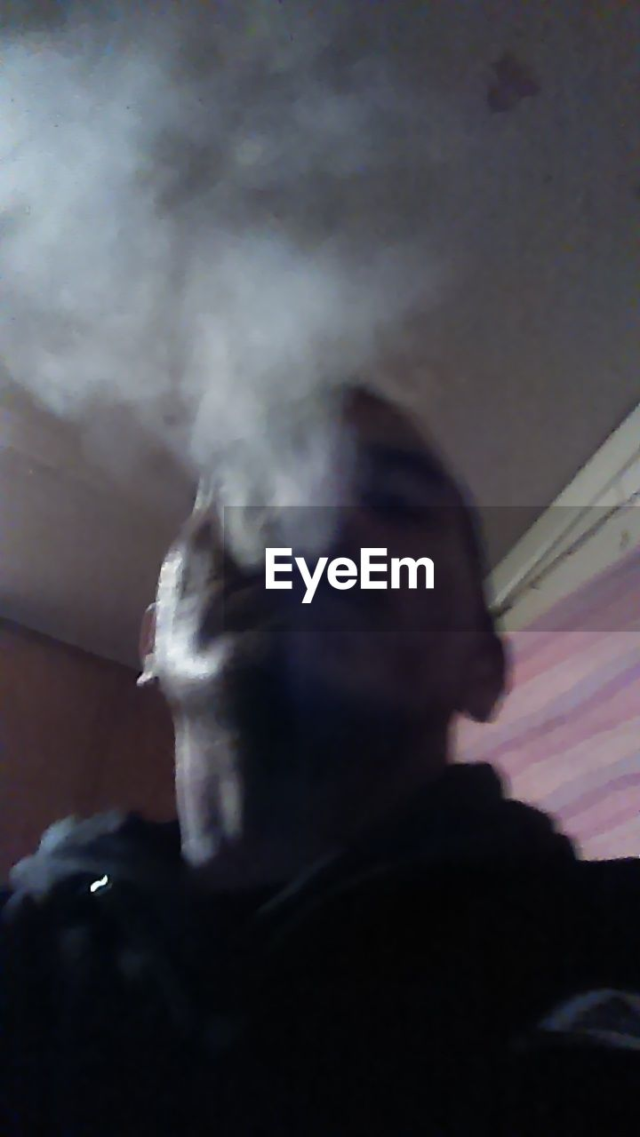 real people, men, smoke - physical structure, leisure activity, one person, lifestyles, indoors, day, close-up, water, nature, one man only, sky, people