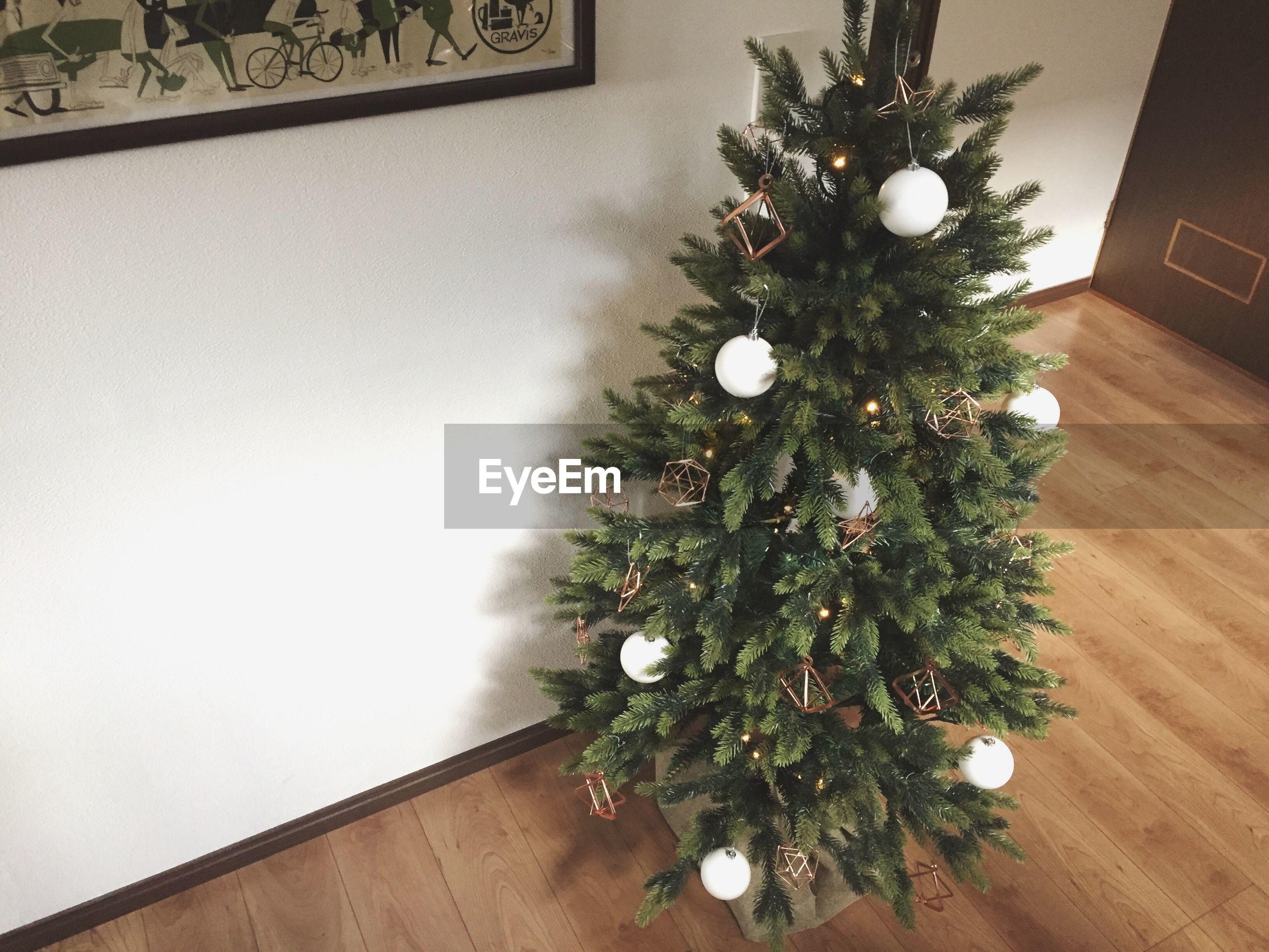 christmas tree, christmas, indoors, christmas decoration, decoration, celebration, christmas ornament, home interior, hardwood floor, table, tradition, tree, no people, living room, illuminated, close-up, day