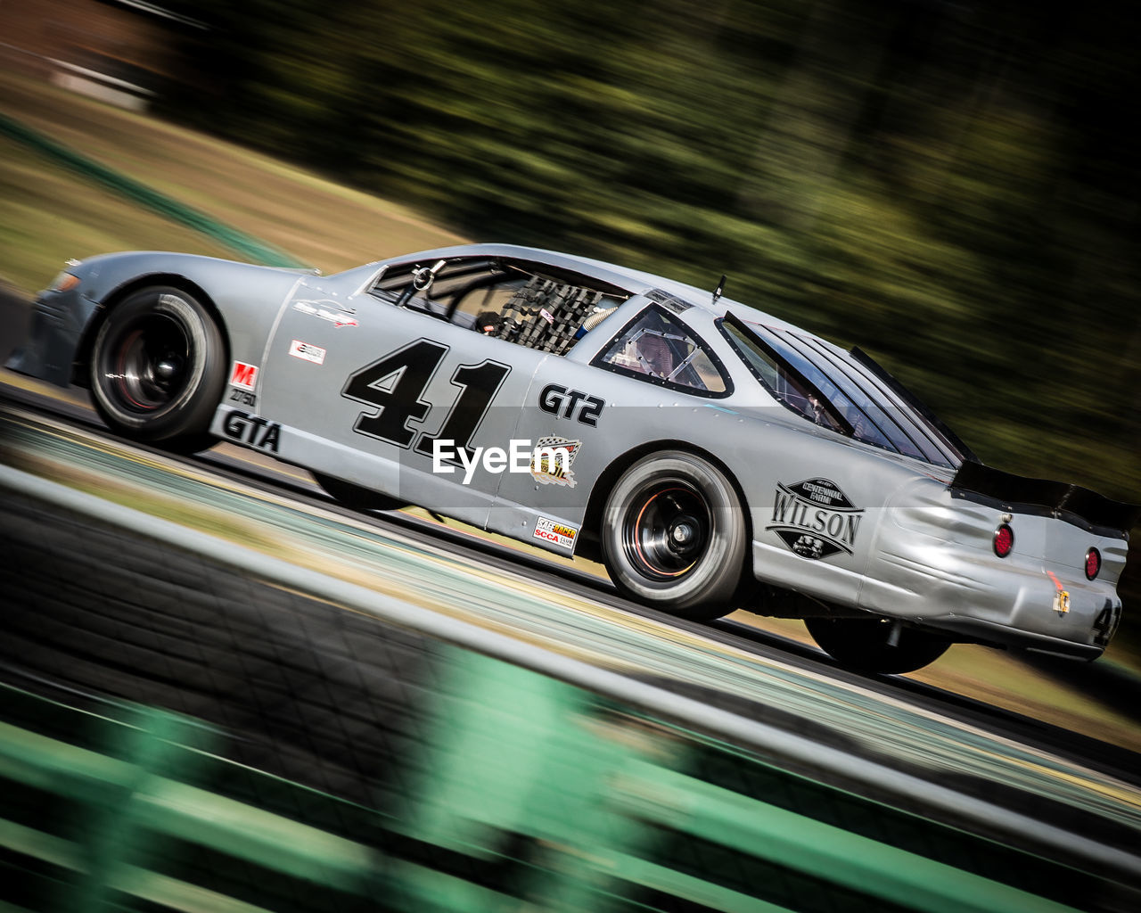 speed, blurred motion, motion, sports race, transportation, day, land vehicle, no people, outdoors, close-up