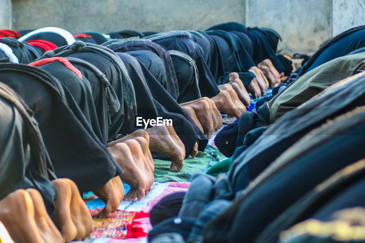 Low section of people praying at mosque