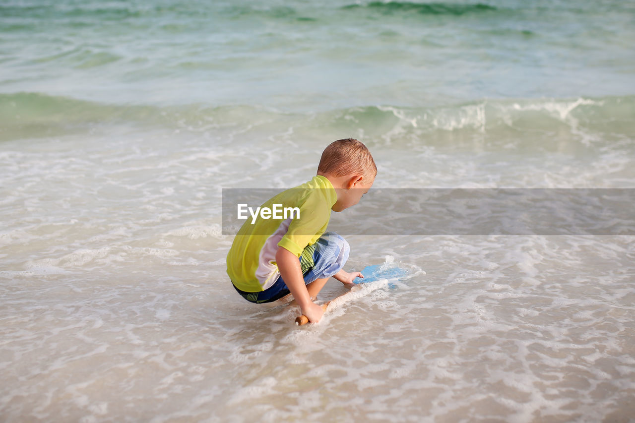 Boy playing at sea shore
