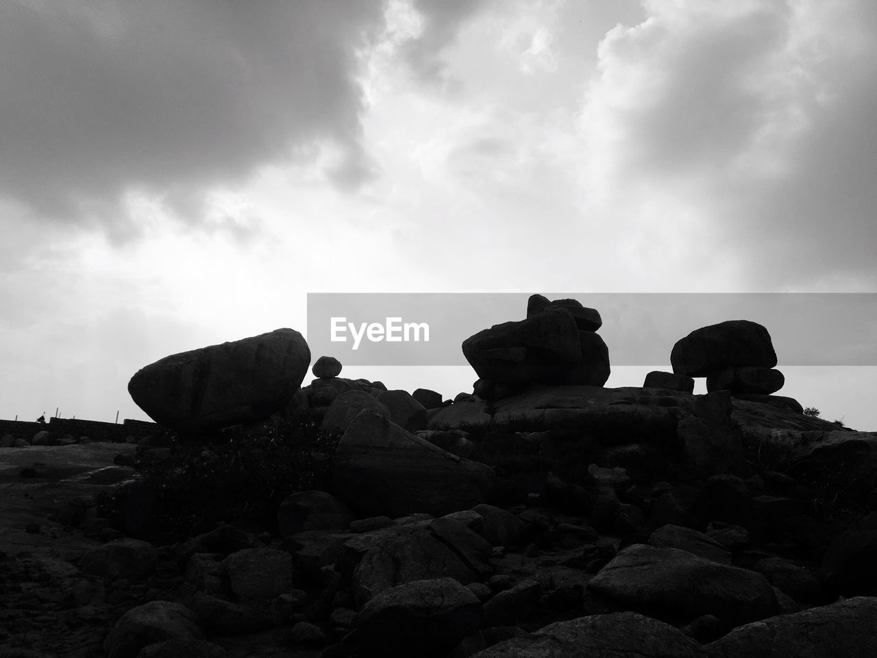rock - object, sky, cloud - sky, rock formation, geology, low angle view, stack, nature, day, no people, outdoors, physical geography, scenics, beauty in nature, rock hoodoo