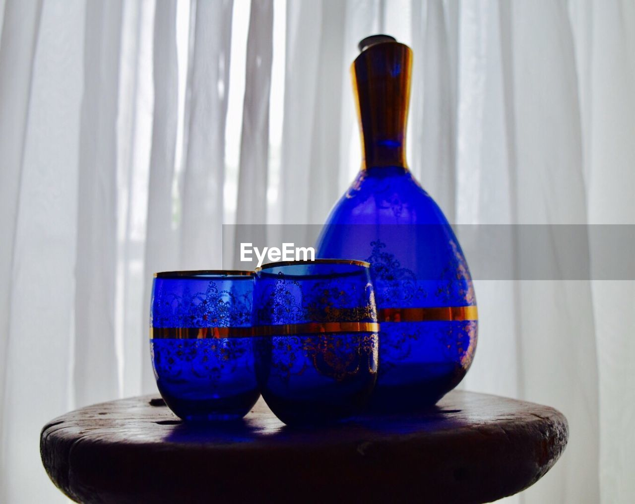 blue, indoors, table, close-up, still life, container, glass - material, no people, transparent, vase, bottle, decoration, ceramics, wall - building feature, single object, focus on foreground, nature, design, creativity, art and craft, glass